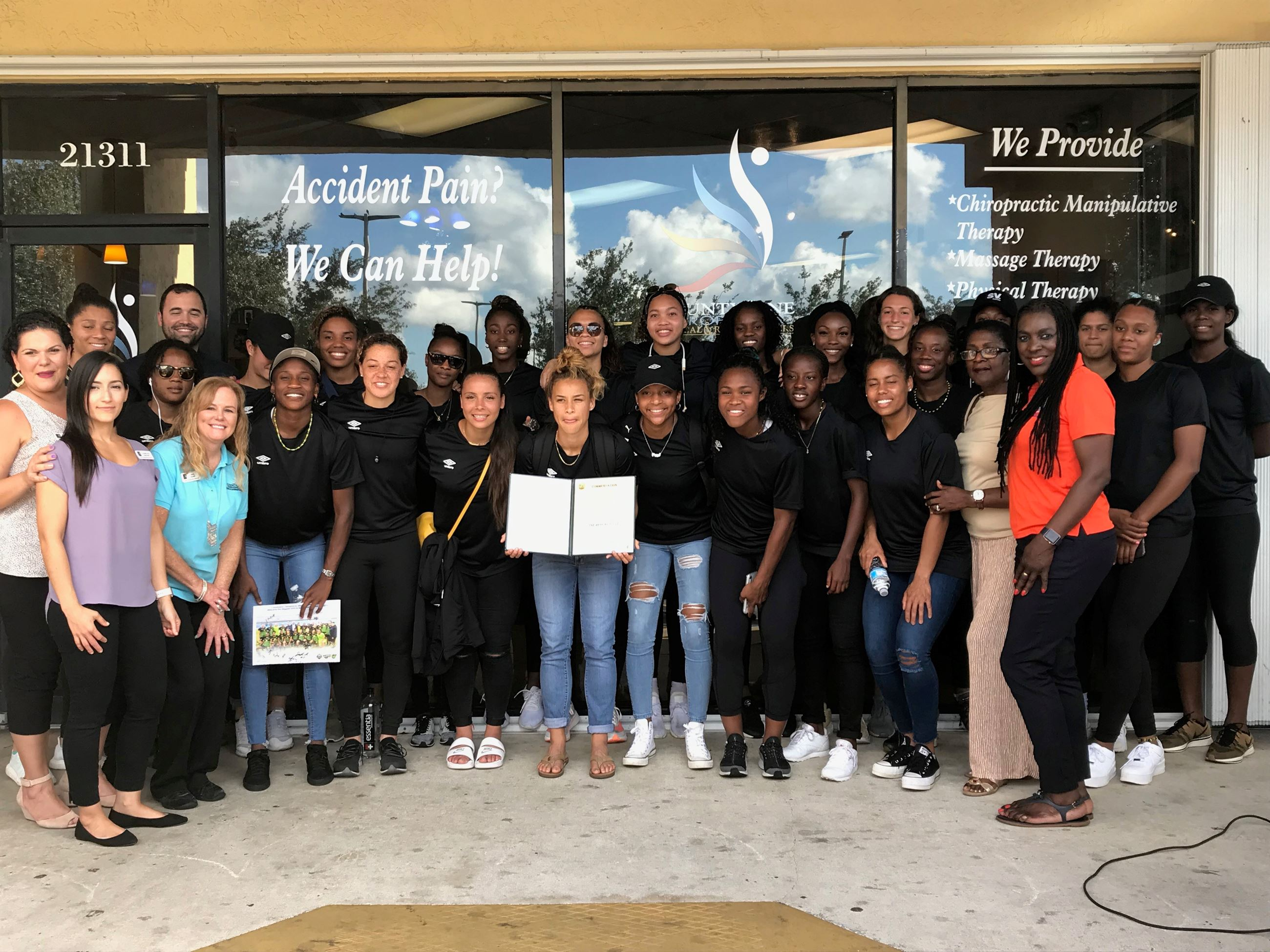 Vice Mayor Davis with the Reggae Girlz at a Pep Rally Sponsored by Countyline Chiropractic